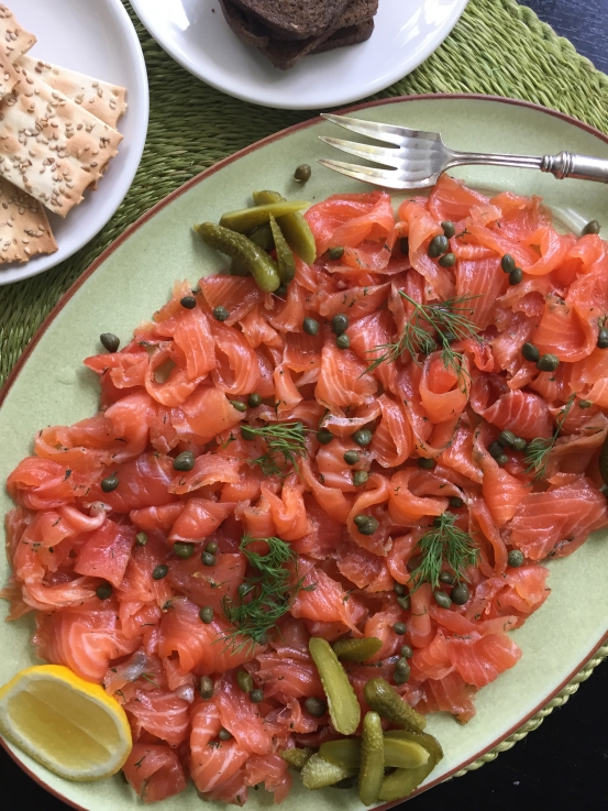 Thinly sliced homemade gravlax can be served on toasted pumpernickel ...